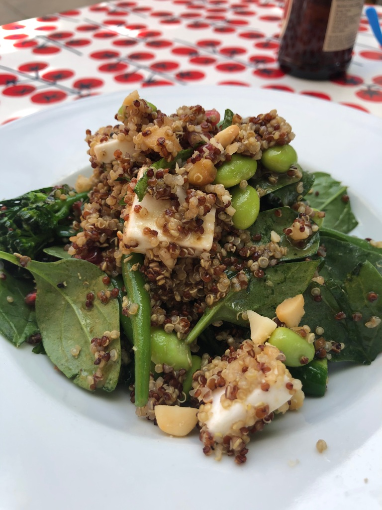 mixed quinoa salad with green vegetables, spinach and vegan feta cheese