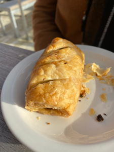 white side plate with small sausage roll pastry on